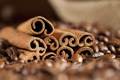 Cinnamon sticks and coffee beans Royalty Free Stock Images
