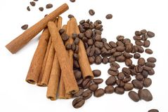 Cinnamon sticks and coffee beans. Closeup isolated on a white background Royalty Free Stock Photography
