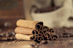 Cinnamon sticks, coffee grains and grinder Stock Image
