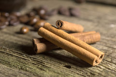Cinnamon sticks with coffee grains Stock Images