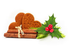 Cinnamon sticks,cookies and holly berry, pine tree Stock Photos