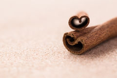 Cinnamon sticks on corkwood background. Stock Photo