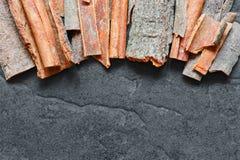 Cinnamon sticks on the dark background Royalty Free Stock Image
