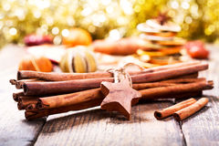 Cinnamon sticks with dried fruits Royalty Free Stock Images