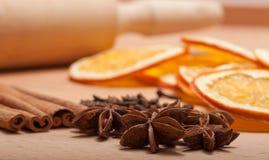 Cinnamon sticks, dried orange and anise Stock Photos