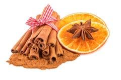 Cinnamon sticks with dried orange Royalty Free Stock Photo
