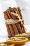 Cinnamon sticks, dried orange slices close up, depth of field Stock Photos