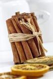 Cinnamon sticks, dried orange slices close up, depth of field Stock Photos