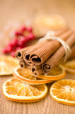 Cinnamon sticks and dried oranges Stock Images