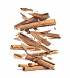 Cinnamon sticks are falling down on a pile,isolated on a white background.  stock image