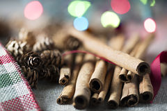 Cinnamon Sticks in Festive  Setting Royalty Free Stock Images