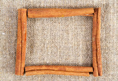 Cinnamon sticks frame on a sacking cloth Royalty Free Stock Image