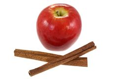 Cinnamon sticks and fresh Red Apple Stock Images