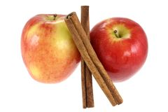 Cinnamon sticks and fresh Red Apple Stock Photography