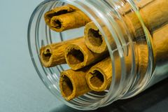 Cinnamon sticks in a glass jar. Closeup of cinnamon sticks in a glass jar with blurred out background Royalty Free Stock Images