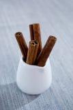 Cinnamon sticks in a glass of white Stock Photos