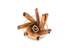 Cinnamon sticks. In glass  on white background Royalty Free Stock Image