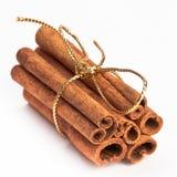Cinnamon sticks with gold ribbon Stock Photo