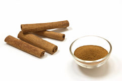 Cinnamon sticks and ground cinnamon Stock Images