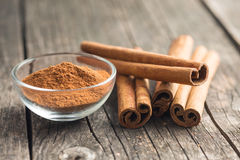 Cinnamon sticks and ground cinnamon. Stock Image