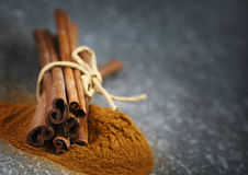 Cinnamon sticks and ground cinnamon. Royalty Free Stock Photo