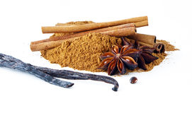 Cinnamon sticks, ground cinnamon, vanilla pods and a star anise Stock Photos