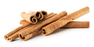 Cinnamon sticks isolated on the white background Royalty Free Stock Photos