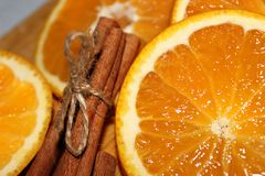 Orange with cinnamon close up stock photos
