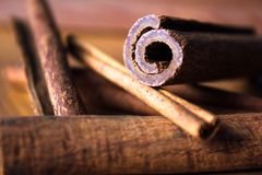 Cinnamon sticks lay on top of each other stock image