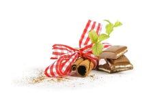 Cinnamon sticks and mint Stock Photos