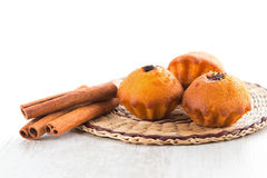 Cinnamon sticks and Muffins. Isolated on white Royalty Free Stock Images
