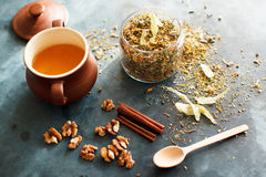 Cinnamon sticks, nuts and a herb collection scattered on a blue Stock Image