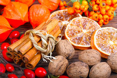 Cinnamon sticks, nuts, orange slices Stock Photos