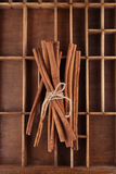 Cinnamon sticks on old wooden box tied Royalty Free Stock Image