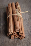 Cinnamon sticks on old wooden table Royalty Free Stock Photo