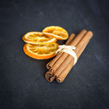 Cinnamon sticks with orange. Aromatic spices concept, spa and exotic Stock Photography