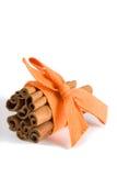 Cinnamon sticks and orange rib. Bunch of cinnamon sticks tied up by orange ribbon Stock Photo