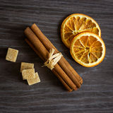 Cinnamon sticks with orange and sugar. Aromatic spices concept, exotic concept royalty free stock image
