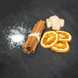 Cinnamon sticks with orange and sugar. Aromatic spices concept, exotic concept Stock Photo