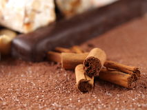 Cinnamon sticks over cocoa powder Royalty Free Stock Image