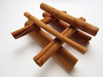 Cinnamon sticks over white background. stock image