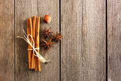 Cinnamon sticks over wooden table Stock Photo