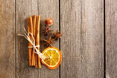 Cinnamon sticks over wooden table Royalty Free Stock Image