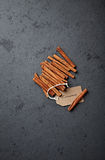 Cinnamon sticks with a paper label Royalty Free Stock Images