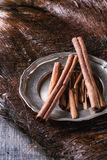Cinnamon sticks on plate Stock Images