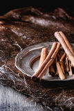 Cinnamon sticks on plate Stock Photo