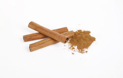 Cinnamon sticks and powder. On white background royalty free stock images