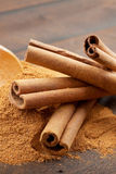 Cinnamon sticks and powder Royalty Free Stock Image