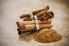 Cinnamon sticks and powder Royalty Free Stock Images