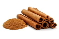 Cinnamon sticks and powder. Isolated on white background Royalty Free Stock Image